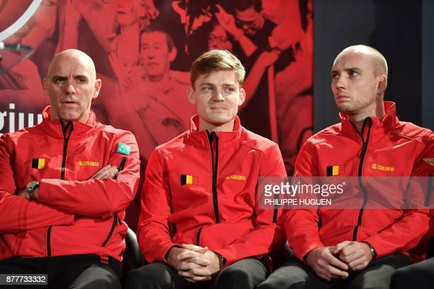 Belgium's captain Johan Van Herck sits next to his players David Goffin and Steve Darcis during the team presentation in Villeneuved'Ascq on November...