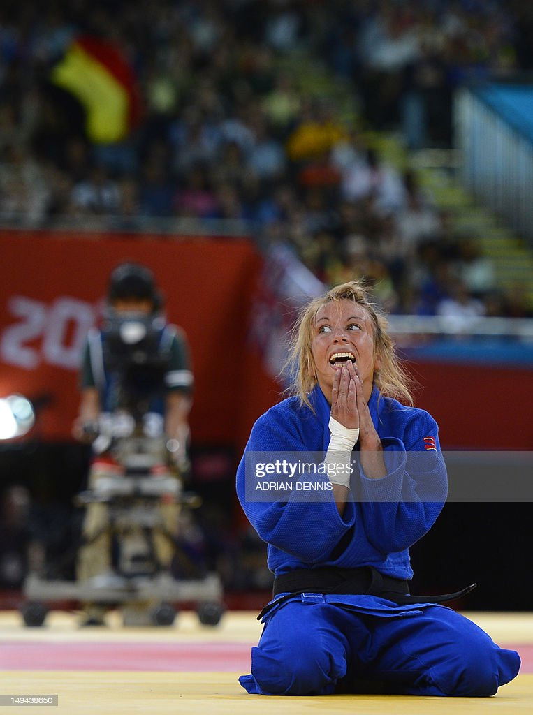 Belgium's <a gi-track='captionPersonalityLinkClicked' href=/galleries/search?phrase=Charline+Van+Snick&family=editorial&specificpeople=6586925 ng-click='$event.stopPropagation()'>Charline Van Snick</a> celebrates after winning the women's -48 kgs contest bronze medal match against Argentina's Paula Pareto at the judo event at the London 2012 Olympic Games on July 28, 2012 in London. AFP PHOTO / ADRIAN DENNIS