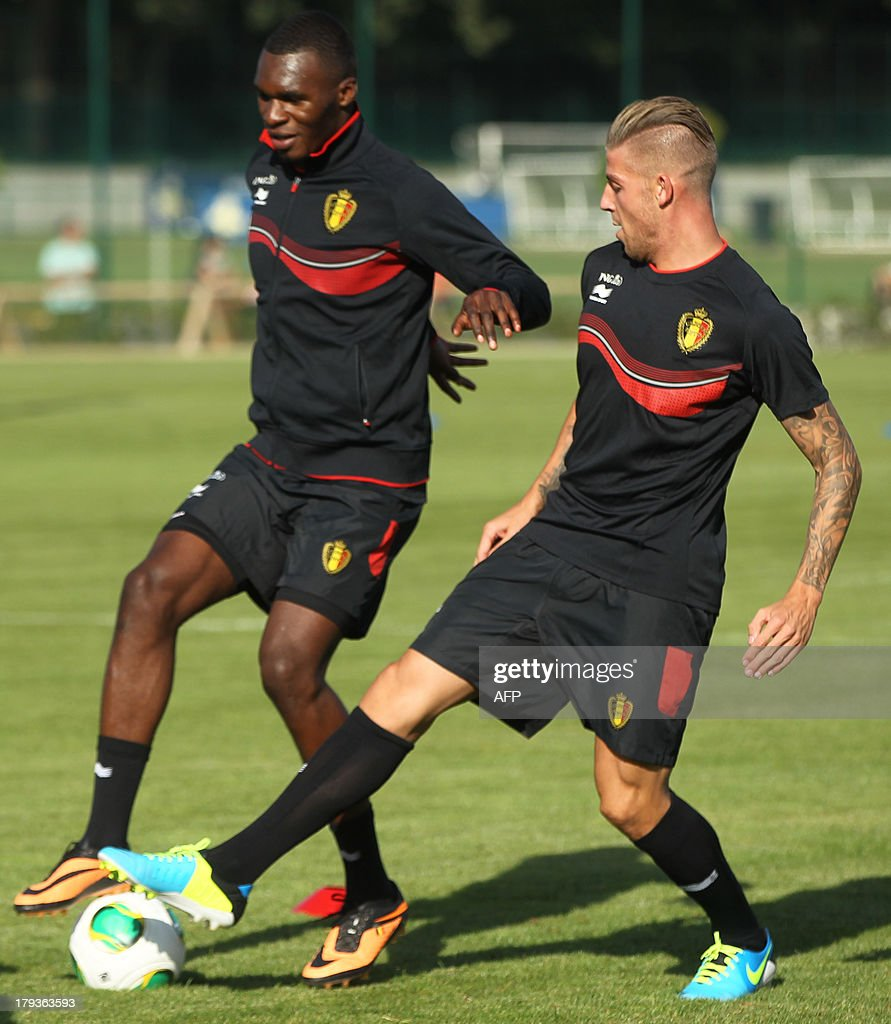 Belgium's Christian Benteke and Belgium's Toby Alderweireld take part in a training session of the Belgian national soccer team, on September 2, 2013 in Brussels, a few days before their 2014 World Cup qualifying match against Scotland in Glasgow. BELGA
