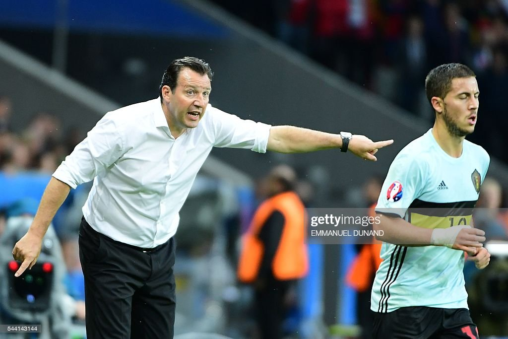 Belgium's coach Marc Wilmots (L) gestures towards Belgium's forward Eden Hazard during the Euro 2016 quarter-final football match between Wales and Belgium at the Pierre-Mauroy stadium in Villeneuve-d'Ascq near Lille, on July 1, 2016. / AFP / EMMANUEL