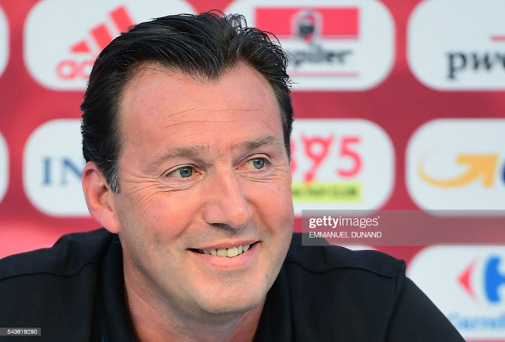 Belgium's coach Marc Wilmots holds a press conference in Le Haillan, southwestern France, on June 29, 2016, ahead of their Euro 2016 quarter-final football match against Wales. / AFP / EMMANUEL