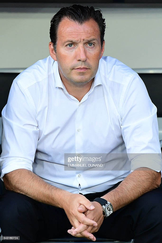 Belgium's coach Marc Wilmots looks on prior to the Euro 2016 round of 16 football match between Hungary and Belgium at the Stadium Municipal in Toulouse on June 26, 2016. / AFP / EMMANUEL