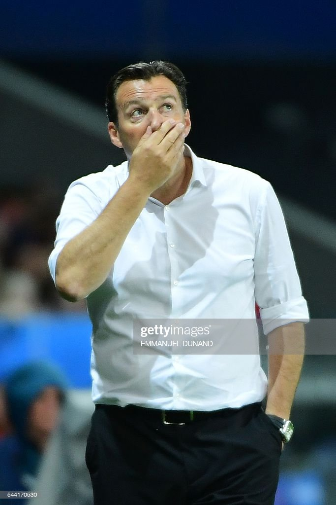 Belgium's coach Marc Wilmots reacts during the Euro 2016 quarter-final football match between Wales and Belgium at the Pierre-Mauroy stadium in Villeneuve-d'Ascq near Lille, on July 1, 2016. / AFP / EMMANUEL