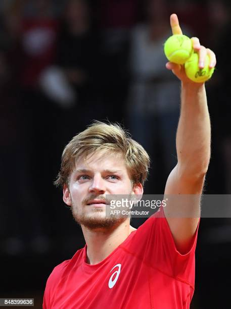 Belgium's David Goffin celebrates after beating Australia's Nick Kyrgios during the Davis Cup semifinal between Belgium and Australia in Brussels on...