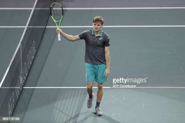 Belgium's David Goffin celebrates winning against France's Adrian Mannarino during their second round match at the ATP World Tour Masters 1000 indoor...