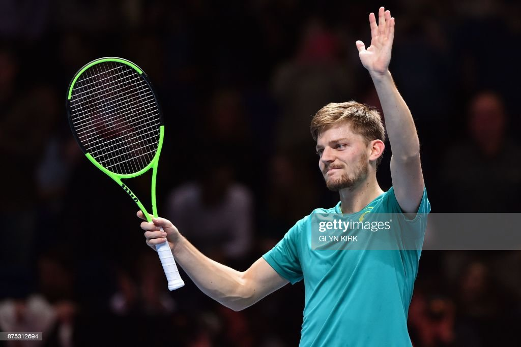 Belgium's David Goffin gestures to the crowd after his straight sets win over Austria's Dominic Thiem in their men's singles round-robin match on day six of the ATP World Tour Finals tennis tournament at the O2 Arena in London on November 17, 2017. David Goffin survived a shaky start to his ATP Finals shootout against friend Dominic Thiem on Friday to advance to the semi-finals, where he has the daunting task of taking on Roger Federer. / AFP PHOTO / Glyn KIRK