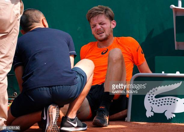 Belgium's David Goffin reacts after falling during his tennis match against Argentina's Horacio Zeballos at the Roland Garros 2017 French Open on...