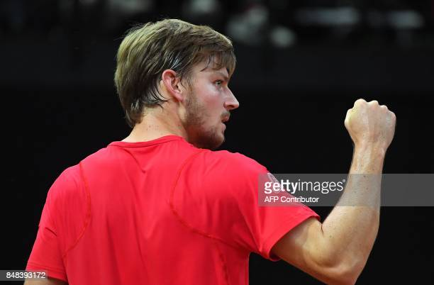 Belgium's David Goffin reacts after scoring in the fourth set against Australia's Nick Kyrgios during the Davis Cup semifinal between Belgium and...