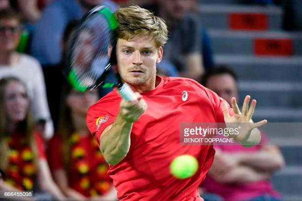 Belgium's David Goffin returns a ball to Italy's Paolo Lorenzi during the Davis Cup World Group quarterfinal tennis match between Belgium and Italy...