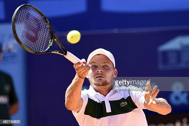 Belgium's David Goffin returns the ball to Austria'sDominic Thiem during their final match at the ATP Swiss Open tennis tournament in Gstaad on...