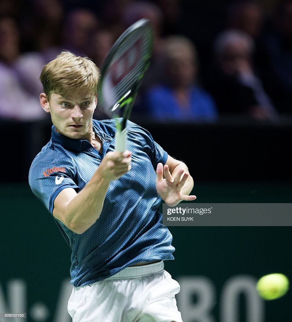 Belgium's David Goffin returns the ball to Cyprus' Marcos Baghdatis during their first round match of the ABN AMRO World Tennis Tournament in Rotterdam, on February 9, 2016. / AFP / ANP / Koen Suyk / Netherlands OUT