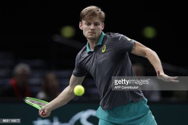 Belgium's David Goffin returns the ball to France's Adrian Mannarino during their second round match at the ATP World Tour Masters 1000 indoor tennis...