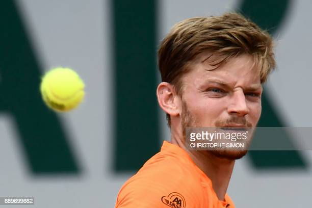 Belgium's David Goffin returns the ball to France's PaulHenri Mathieu during their tennis match at the Roland Garros 2017 French Open on May 29 2017...