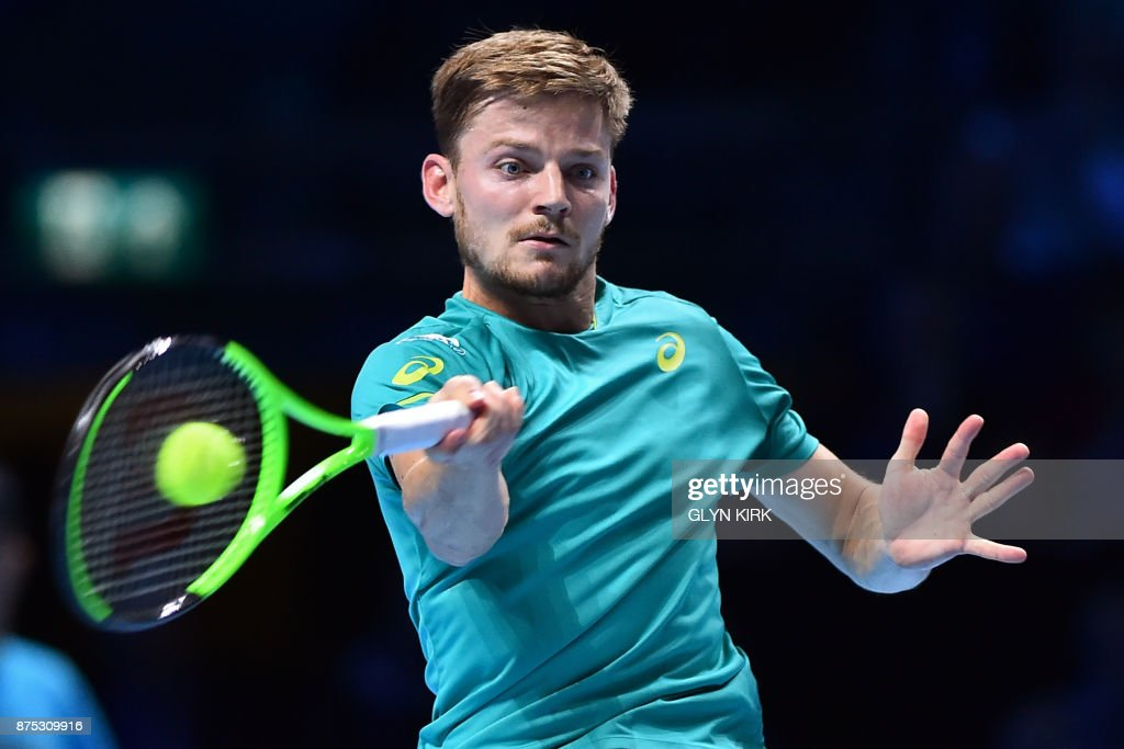 Belgium's David Goffin returns to Austria's Dominic Thiem during a men's singles round-robin match on day six of the ATP World Tour Finals tennis tournament at the O2 Arena in London on November 17, 2017. / AFP PHOTO / Glyn KIRK