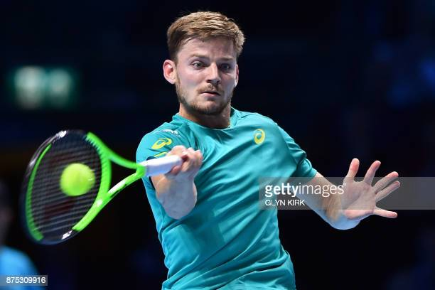 Belgium's David Goffin returns to Austria's Dominic Thiem during a men's singles roundrobin match on day six of the ATP World Tour Finals tennis...