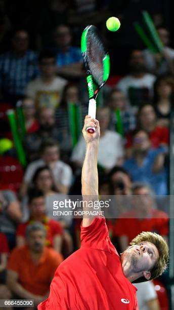 Belgium's David Goffin serves a ball to Italy's Paolo Lorenzi during the Davis Cup World Group quarterfinal tennis match between Belgium and Italy on...