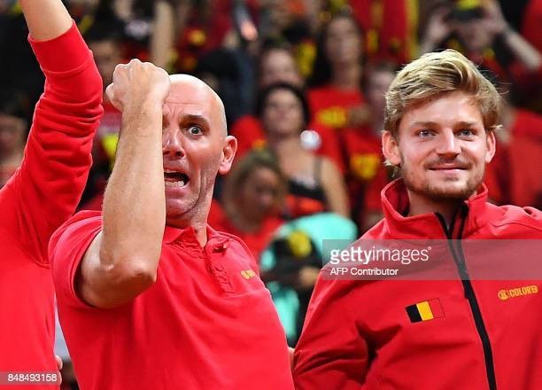Belgium's Davis Cup team captain Johan Van Herck celebrates with David Goffin after winning against Australia during the Davis Cup semifinal between...