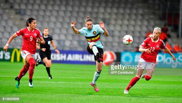 Belgium's defender Heleen Jaques controls the ball as Denmark's forward Nadia Nadim and Denmark's forward Stine Larsen look on during the UEFA...