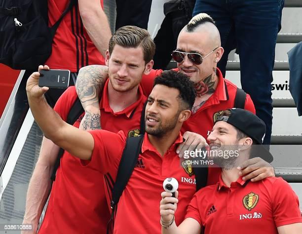 Belgium's defender Jan Vertonghen midfielder Moussa Dembele midfielder Radja Nainggolan and midfielder Dries Mertens take a selfie photograph before...