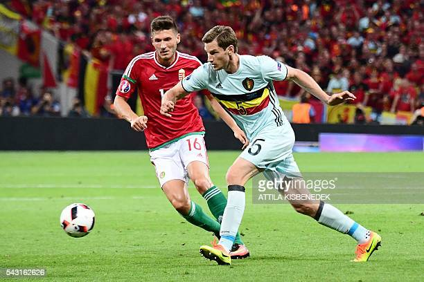 Belgium's defender Jan Vertonghen vies for the ball with Hungary's midfielder Adam Pinter during the Euro 2016 round of 16 football match between...