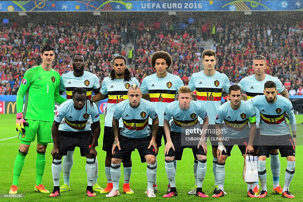 Belgium's defender Jordan Lukaku, Belgium's midfielder Radja Nainggolan, Belgium's midfielder Kevin De Bruyne, Belgium's forward Eden Hazard and Belgium's forward Yannick Ferreira-Carrasco and (back row, LtoR) Belgium's goalkeeper Thibaut Courtois, Belgium's forward Romelu Lukaku, Belgium's defender Jason Denayer, Belgium's midfielder Axel Witsel, Belgium's defender Thomas Meunier and Belgium's defender Toby Alderweireld pose for a team photo ahead the Euro 2016 quarter-final football match between Wales and Belgium at the Pierre-Mauroy stadium in Villeneuve-d'Ascq near Lille, on July 1, 2016. / AFP / EMMANUEL