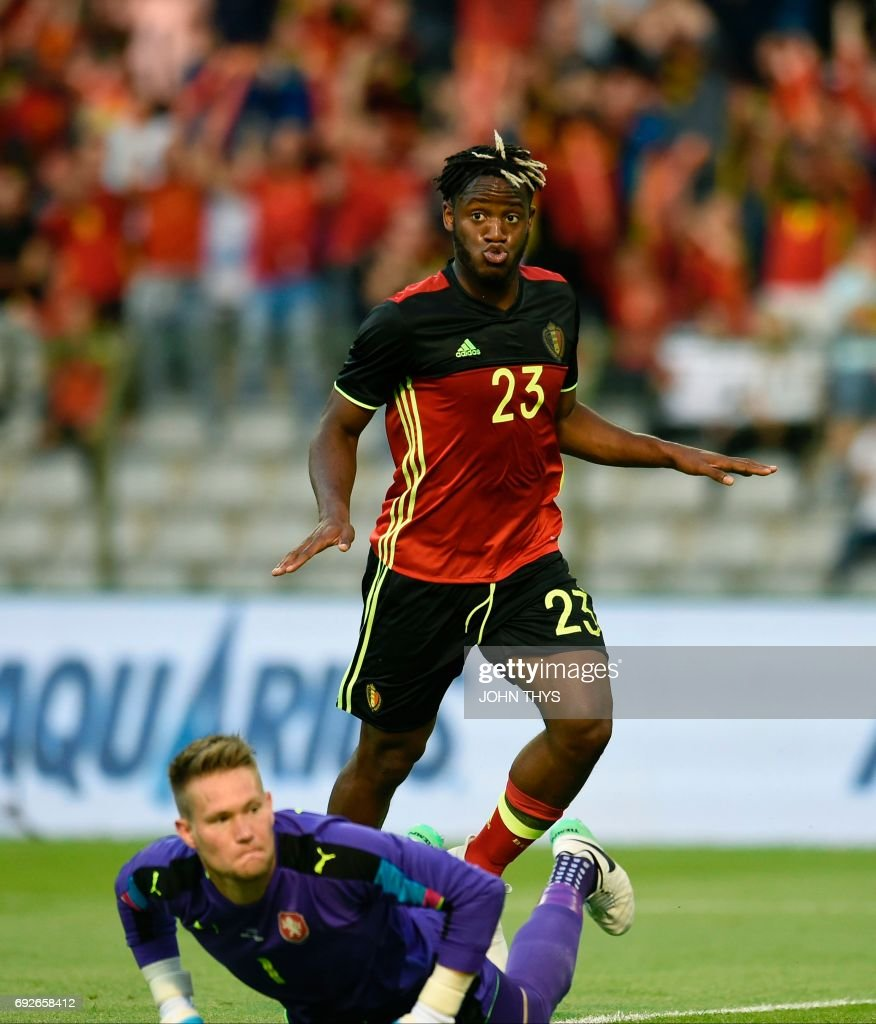 Belgium s defender Michy Batshuayi C celebrates after scoring