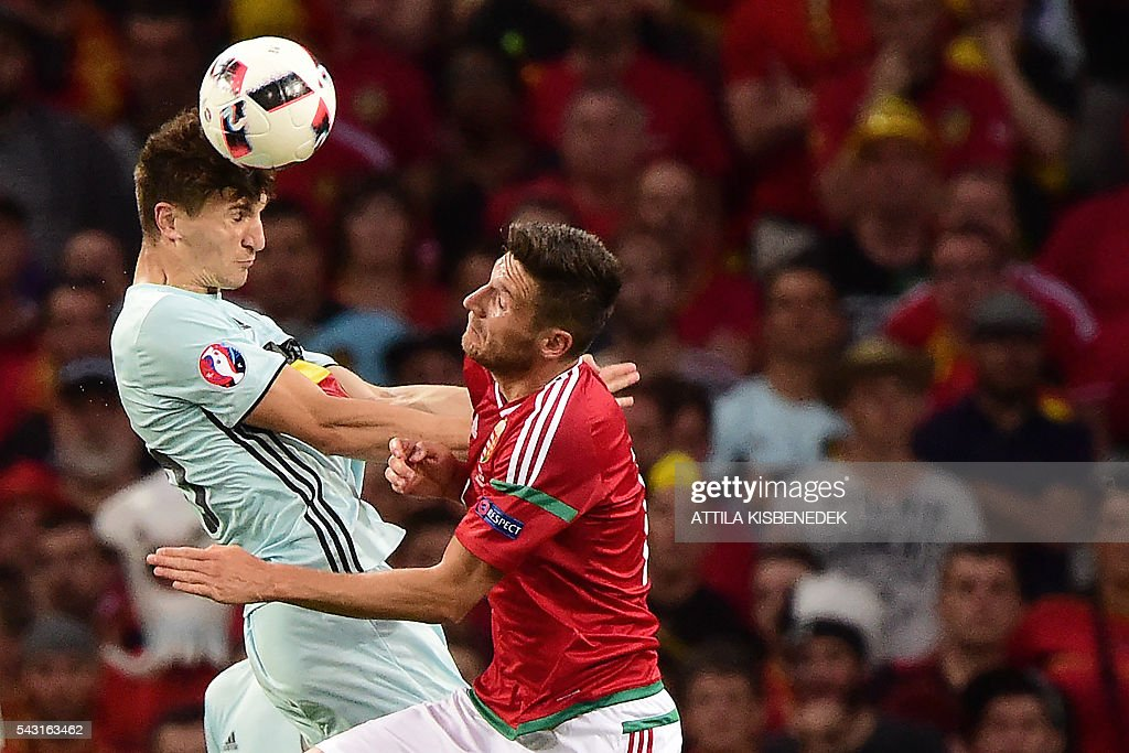 Belgium's defender Thomas Meunier (L) jumps for the ball with Hungary's midfielder Adam Pinter during the Euro 2016 round of 16 football match between Hungary and Belgium at the Stadium Municipal in Toulouse on June 26, 2016. / AFP / Attila KISBENEDEK