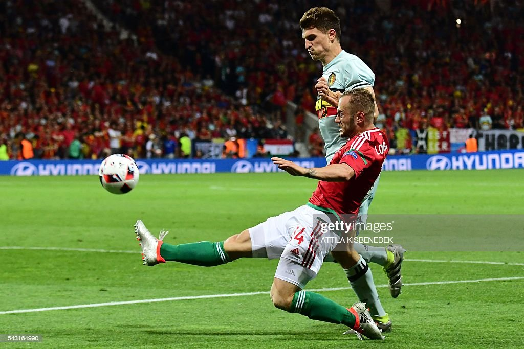 Belgium's defender Thomas Meunier (L) vies for the ball with Hungary's forward Gergo Lovrencsics during the Euro 2016 round of 16 football match between Hungary and Belgium at the Stadium Municipal in Toulouse on June 26, 2016. / AFP / ATTILA