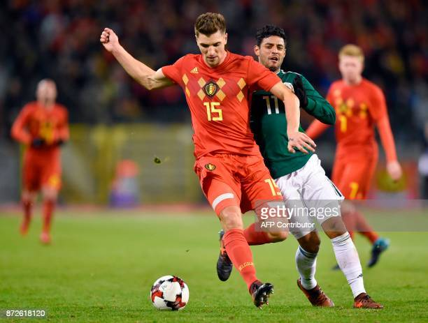 Belgium's defender Thomas Meunier vies for the ball with Mexico's forward Carlos Vela during the international friendly football match between...