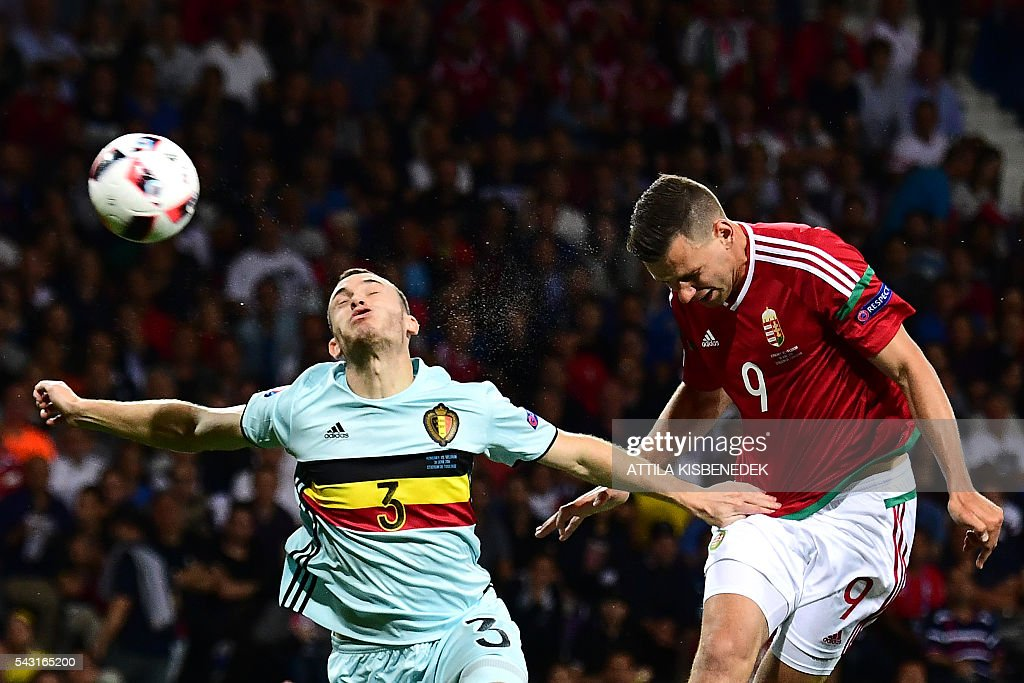 Belgium's defender Thomas Vermaelen (L) jumps for the ball with Hungary's forward Adam Szalai during the Euro 2016 round of 16 football match between Hungary and Belgium at the Stadium Municipal in Toulouse on June 26, 2016. / AFP / ATTILA