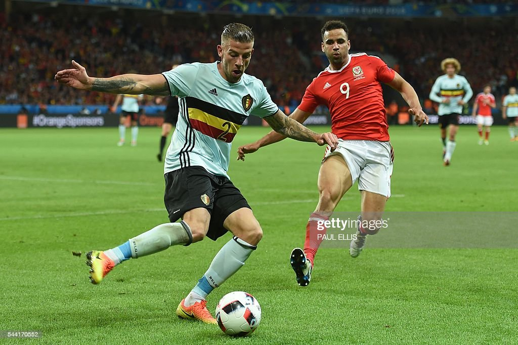 Belgium's defender Toby Alderweireld and Wales' forward Hal Robson-Kanu vie for the ball during the Euro 2016 quarter-final football match between Wales and Belgium at the Pierre-Mauroy stadium in Villeneuve-d'Ascq near Lille, on July 1, 2016. / AFP / PAUL