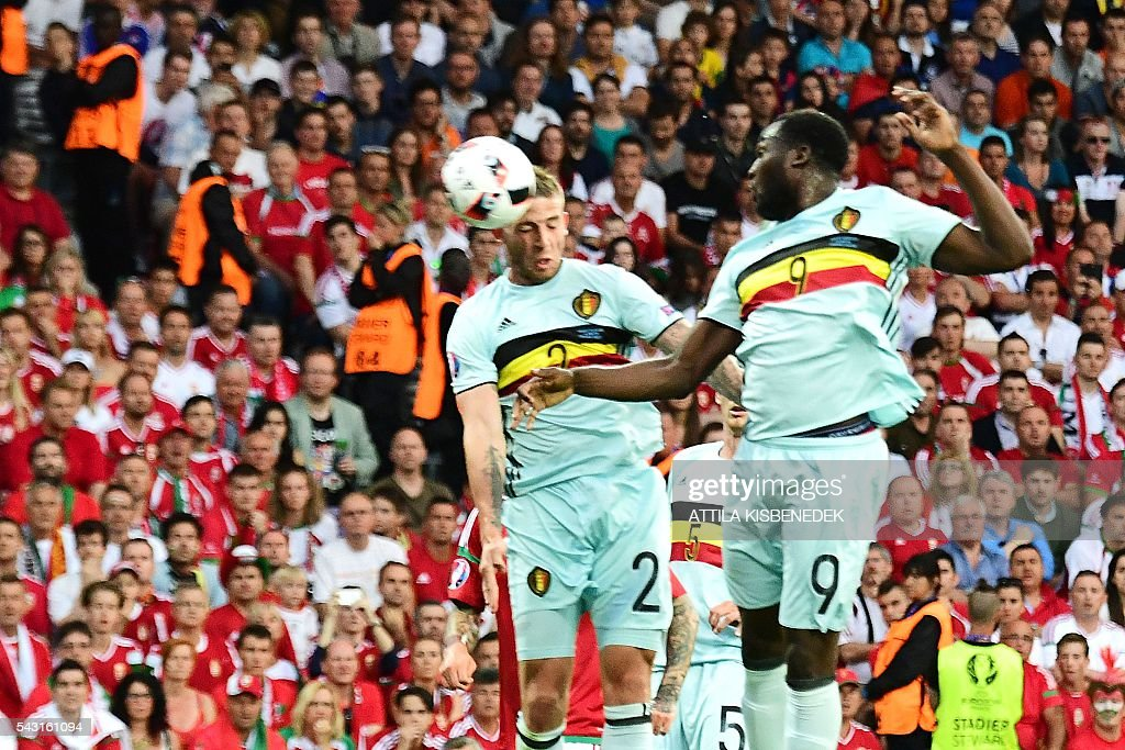 Belgium's defender Toby Alderweireld (L) heads the ball and scores the first goal during the Euro 2016 round of 16 football match between Hungary and Belgium at the Stadium Municipal in Toulouse on June 26, 2016. / AFP / ATTILA