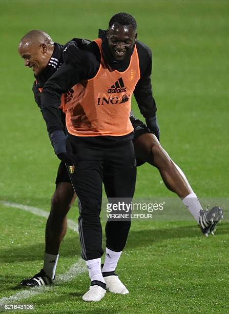 Belgium's defender Vincent Kompany and Belgium's Congolese forward Romelu Lukaku attend a training session of the Belgian national football team on...