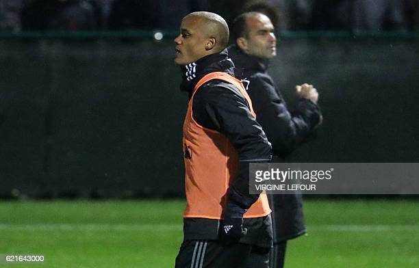 Belgium's defender Vincent Kompany and Belgium's head coach Roberto Martinez attend a training session of the Belgian national football team on...