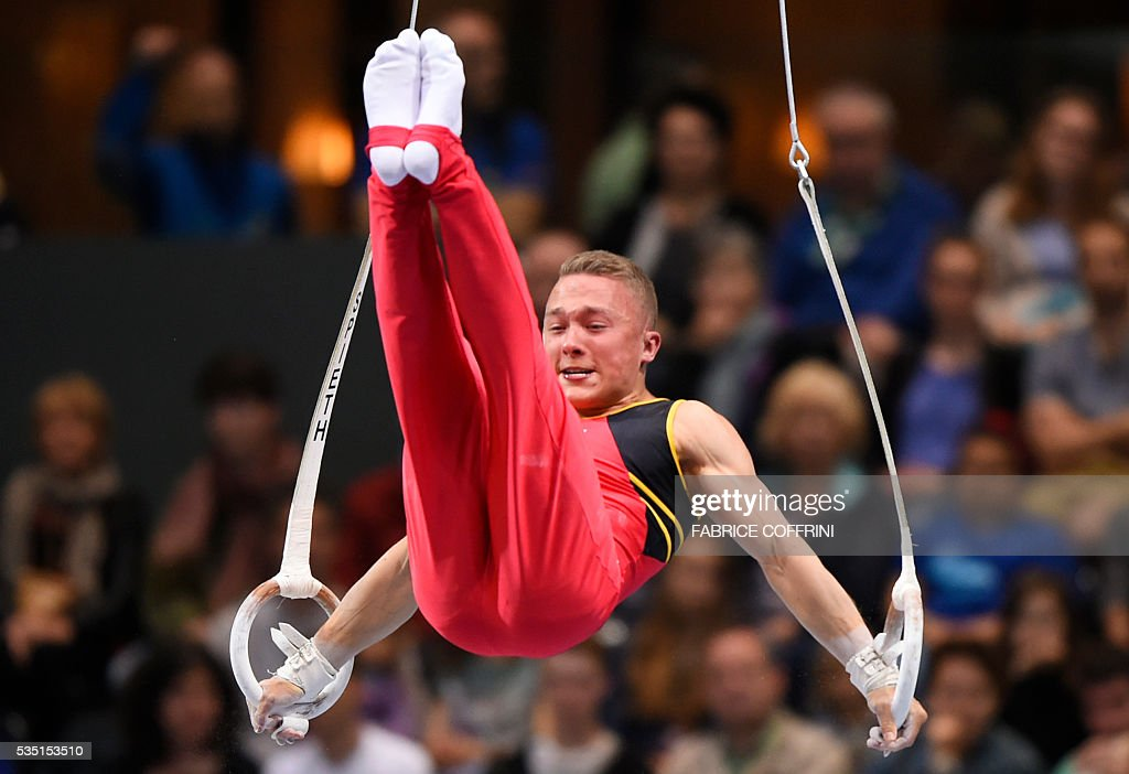 Belgiums Dennis Goossens performs during the Mens Rings competition of the European Artistic Gymnastics Championships 2016 in Bern, Switzerland on May 29, 2016. / AFP / FABRICE