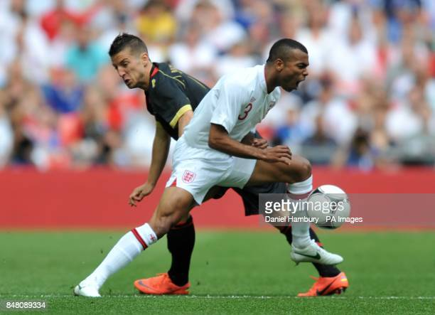 Belgium's Dries Mertens and England's Ashley Cole battle for the ball