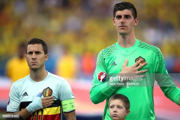 Belgium's Eden Hazard and goalkeeper Thibaut Courtois during the national anthem
