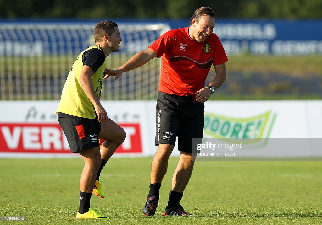 Belgium's Eden Hazard (L) and head coach Marc Wilmots attend on September 4, 2013 a training session of the Belgian national football team, the Red Devils, in Brussels ahead of a 2014 FIFA World Cup qualification match against Scotland on September 6 in Glasgow.