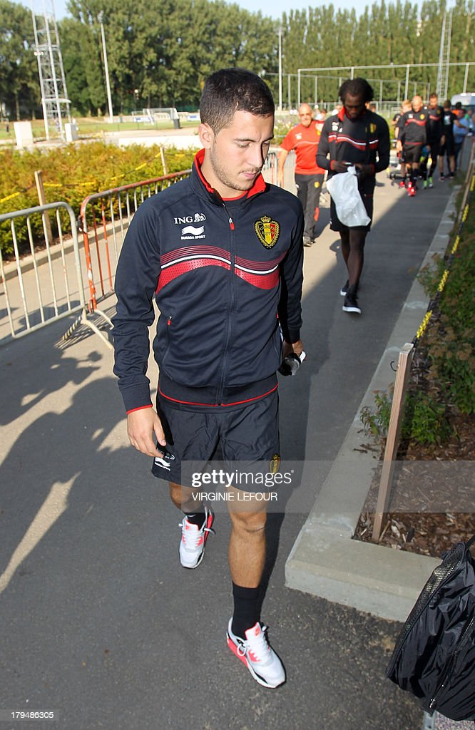 Belgium's Eden Hazard arrives on September 4, 2013 for a training session of the Belgian national football team, the Red Devils, in Brussels ahead of a 2014 FIFA World Cup qualification match against Scotland on September 6 in Glasgow. AFP PHOTO / BELGA / VIRGINIE LEFOUR - BELGIUM OUT -
