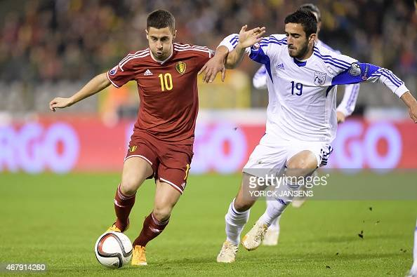 Belgium's Eden Hazard vies with Cyprus' Constantinos Laifis during the Euro 2016 qualifying round football match between Belgium and Cyprus at the...