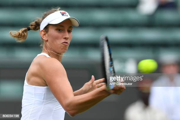 Belgium's Elise Mertens returns against US player Venus Williams during their women's singles first round match on the first day of the 2017...