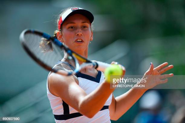 Belgium's Elise Mertens returns the ball to Netherlands' Richel Hogenkamp during their tennis match at the Roland Garros 2017 French Open on May 31...