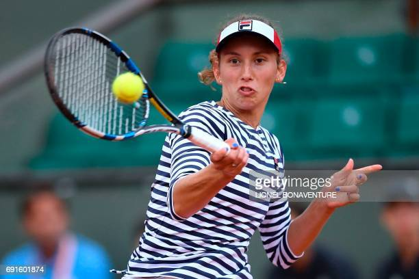 Belgium's Elise Mertens returns the ball to US Venus Williams during their tennis match at the Roland Garros 2017 French Open on June 2 2017 in Paris...