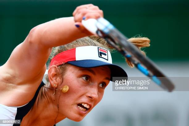 Belgium's Elise Mertens serves the ball to Australia's Daria Gavrilova during their tennis match at the Roland Garros 2017 French Open on May 29 2017...