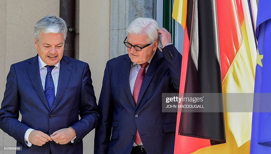 Belgium's Foreign minister Didier Reynders (L) and Germany's Foreign minister Frank-Walter Steinmeier arrive for a group photo at the villa Borsig prior to post-Brexit talks in Berlin on June 25, 2016. Foreign ministers of the six founding members of the European project meet to discuss the bloc's future in the wake of Britain's decision to leave. / AFP / John MACDOUGALL
