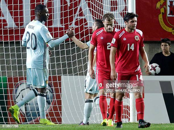 Belgium's forward Christian Benteke celebrates his goal with teammate Dries Mertens during the WC 2018 football qualification match Gibraltar vs...