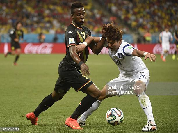 Belgium's forward Divock Origi vies with South Korea's defender Hong JeongHo during a Group H football match between South Korea and Belgium at the...