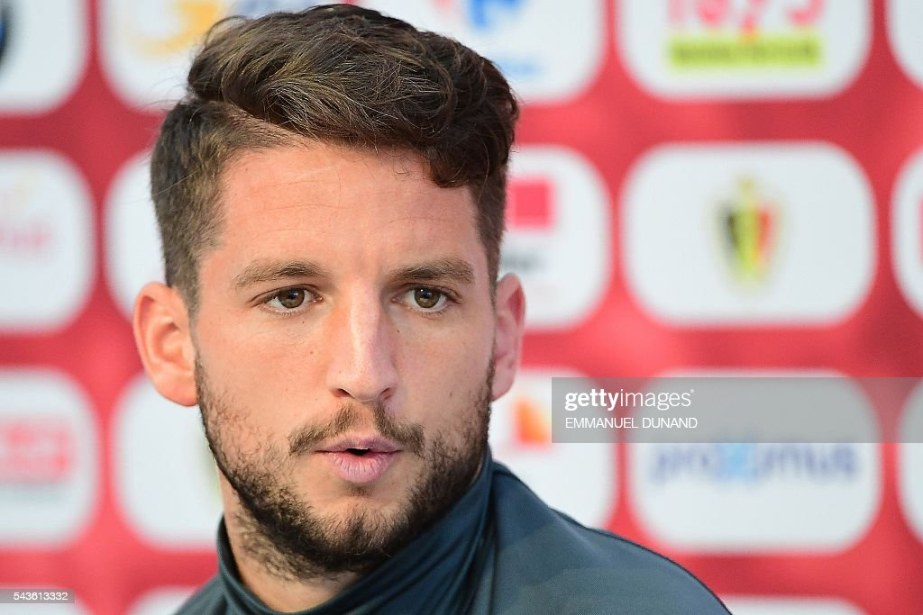 Belgium's forward Dries Mertens holds a press conference in Le Haillan, southwestern France, on June 29, 2016, ahead of their Euro 2016 quarter-final football match against Wales. / AFP / EMMANUEL