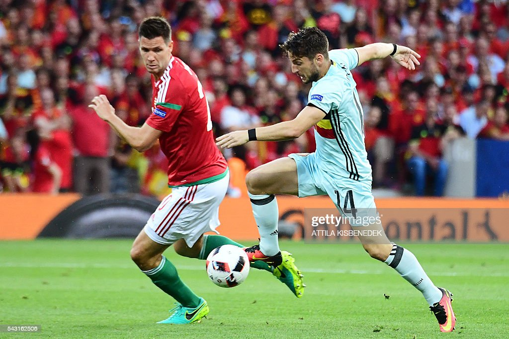 Belgium's forward Dries Mertens (R) vies for the ball with Hungary's defender Adam Lang during the Euro 2016 round of 16 football match between Hungary and Belgium at the Stadium Municipal in Toulouse on June 26, 2016. / AFP / ATTILA