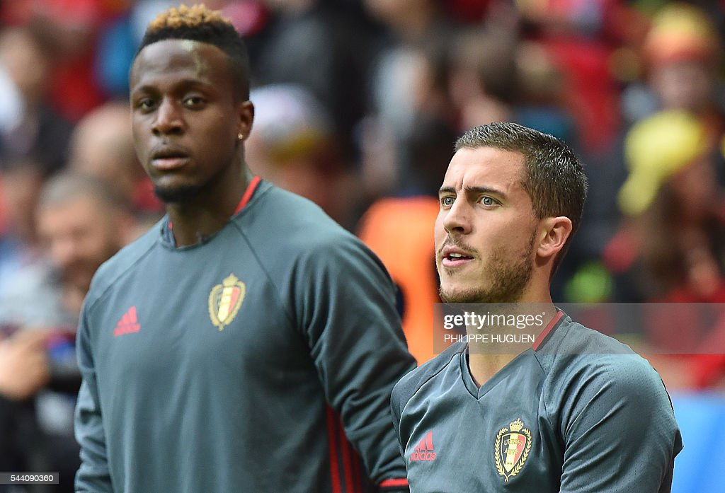 Belgium's forward Eden Hazard and Belgium's forward Divock Origi (L) warm up ahead of the Euro 2016 quarter-final football match between Wales and Belgium at the Pierre-Mauroy stadium in Villeneuve-d'Ascq near Lille, on July 1, 2016. / AFP / PHILIPPE